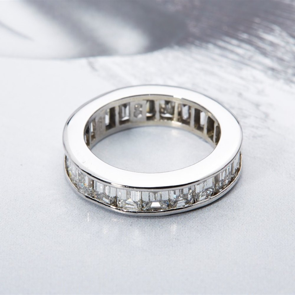 Platinum 6.70cts Baguette and Emerald Cut Diamond Full Eternity Ring