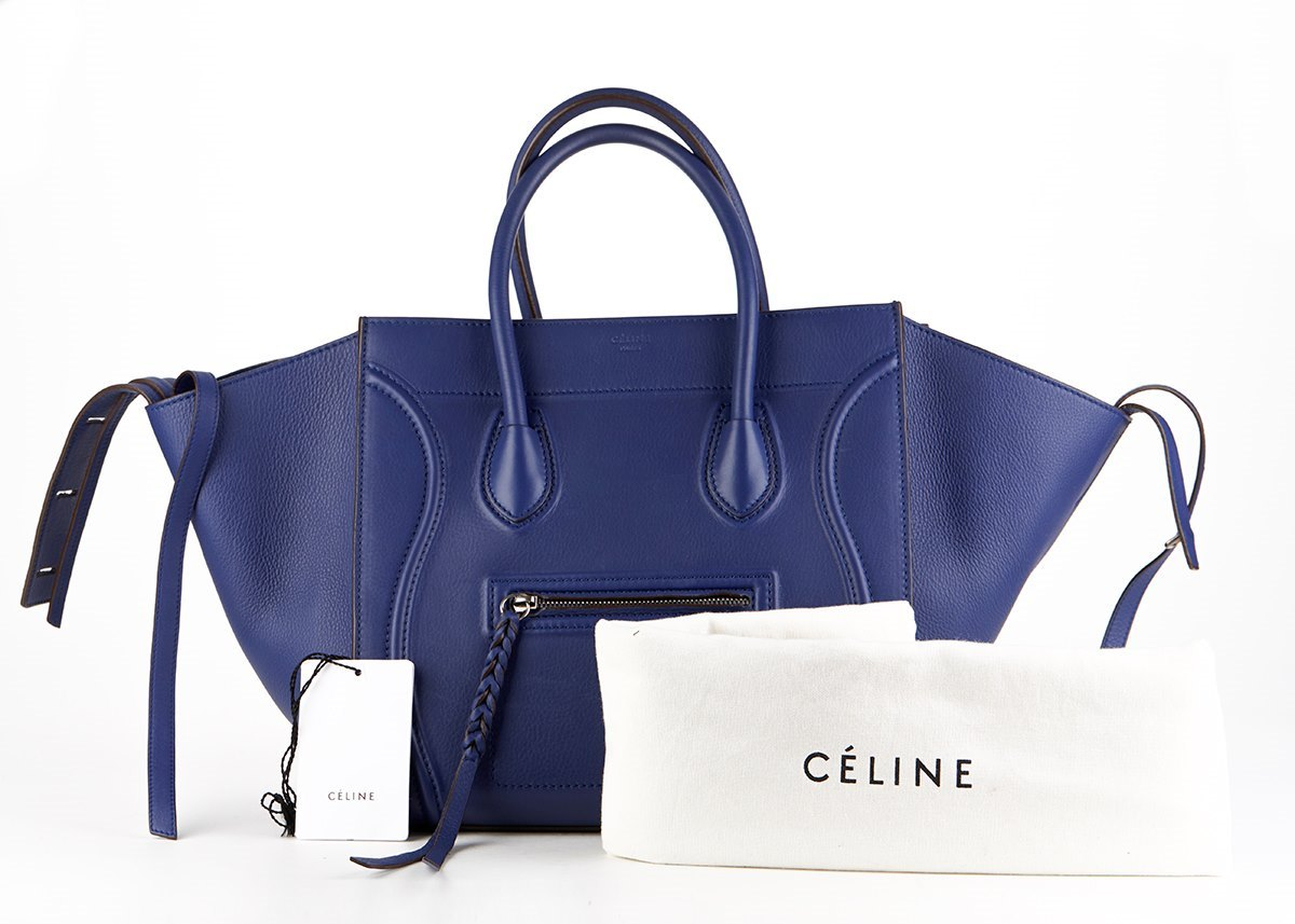 owned celine black drummed calfskin leather medium phantom luggage tote bag
