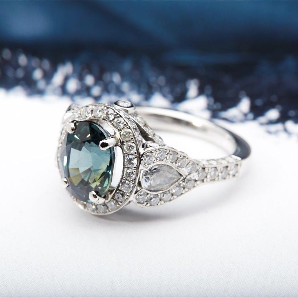 Platinum 5.75cts Natural Royal Blue Sapphire & Diamond Ring